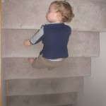 Toddler Asleep On Stairs
