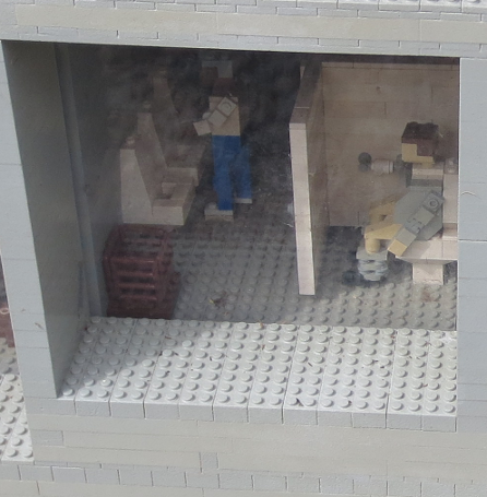 Miniland Lego Guy on the toilet