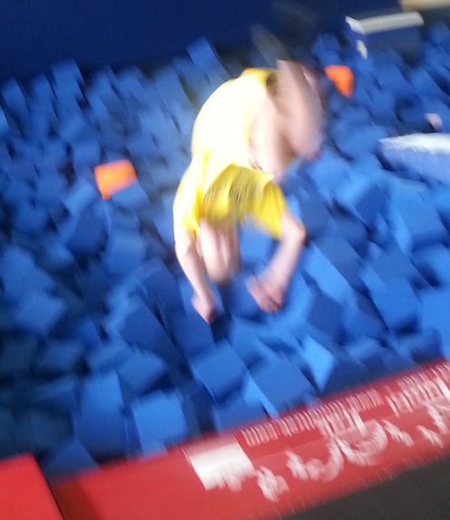 Philip doing a back flip into the foam pit at EnergyPlex