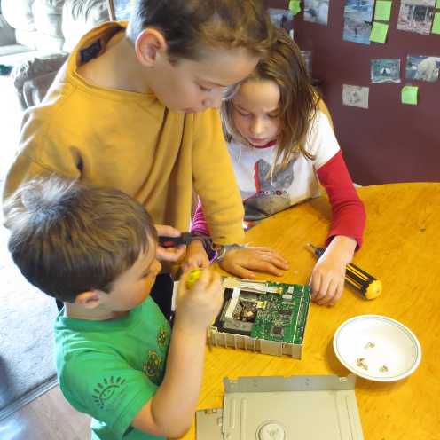 Kids Taking Apart CDROM Drive