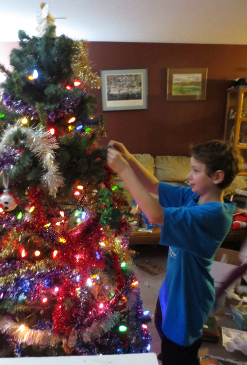 Philip Placing an Ornament