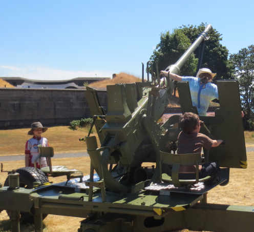 Kids Playing On Anti Aircraft Gun