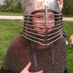 Margaret Trying On an Armour Helmet